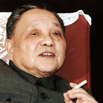 Image: File photo shows China's leader Deng Xiaoping smoking a cigarette in Beijing