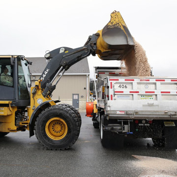 Image: Heavy equipment operator Kelly Von Ellingtton, of Egg Harbor Township, N.J., loads salt onto his truck in Northfield, N.J