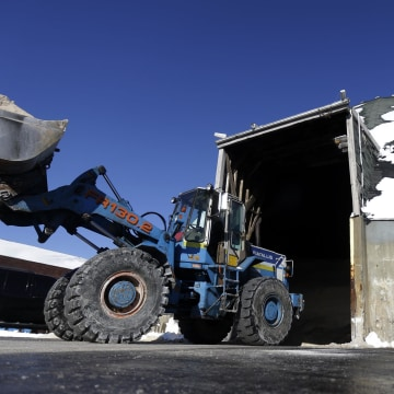 Image: A front loader carries salt out of a mine to be placed on a truck use to salt the streets of Newark, N.J.