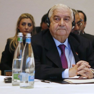 Image: Syria's Foreign Minister Walid al-Moallem looks on at the start of peace talks on Wednesday in Montreux, Switzerland.
