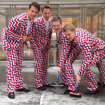 Members of  Norway's Men's Olympic Curling Team wear their new Sochi 2014 suits as they pose in New York on Tuesday.