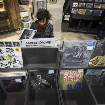 A man peruses albums displayed inside of the record store Rough Trade in the Williamsburg neighborhood of New York