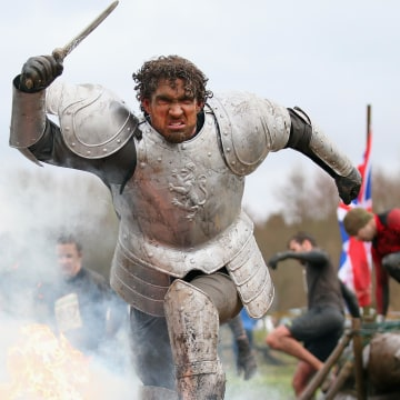 A competitor dressed as a knight runs through a fire during the Tough Guy Challenge on Jan. 26.