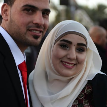 Izzat abu Hilu, 26, and his bride Rajaa' Hilu, 21.