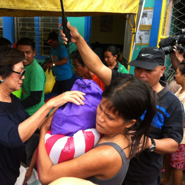 Remedios Petilla, mayor of Palo, handing out aid to locals.