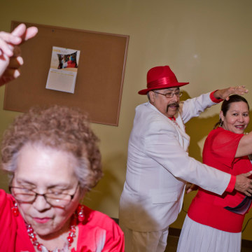 Image: Consuelo Martinez, left,  Eloy Guerrero, center, and Gloria Barrios, members of the group Los Danzonera Pilsen, perform at Casa Maravilla in Chicago.