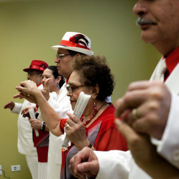 Image: Los Danzonera Pilsen, a group of senior citizens  who dance traditional 1940's style Cuban dancing, perform at Casa Maravilla in Chicago.