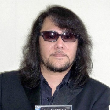 Composer Mamoru Samuragochi poses with a CD of his music in 2011.