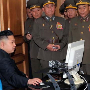 Image: North Korean leader Kim looks at a computer screen