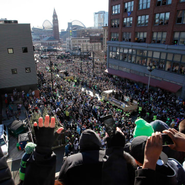 Image: Fans celebrate as the Seahawks make their way through downtown during the NFL team's Super Bowl victory parade in Seattle