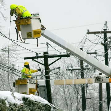 Image: PSE&G linemen work in East Brunswick, N.J. to restore power to tens of thousands of customers who lost service after ice coated trees and transmission lines on Feb. 5.