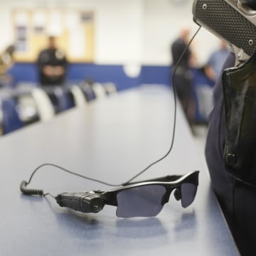 Image: An on-body police video camera is clipped to a Los Angeles Police officers' glasses during a demonstration for media