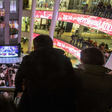 Image: People watch television broadcast of the Opening Ceremony