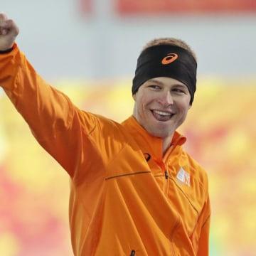 Image: Sven Kramer of the Netherlands celebrates after winning the gold.