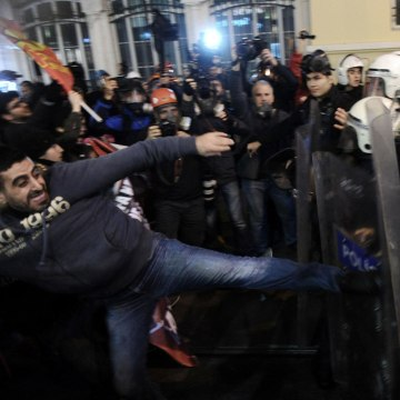 Image: A protester clashes with riot police