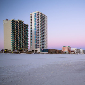 Image: the Phoenix All Suites Hotel, left, and the Island Tower condominium building in Gulf Shores, Ala.