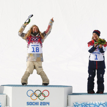 Image: Second placed Finland's Rukajarvi, winner Anderson of the U.S. and third placed Britain's Jones celebrate during a flower ceremony after the women's snowboard slopestyle finals at the 2014 Sochi Winter Olympics in Rosa Khutor