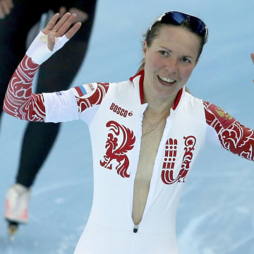 Image: Olga Graf of Russia waves after her women's 3000 meters speed skating race during the 2014 Sochi Winter Olympics
