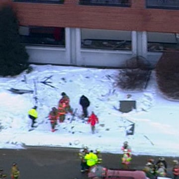 Image: First responders work around debris from an explosion at a plant in Peterborough, N.H.