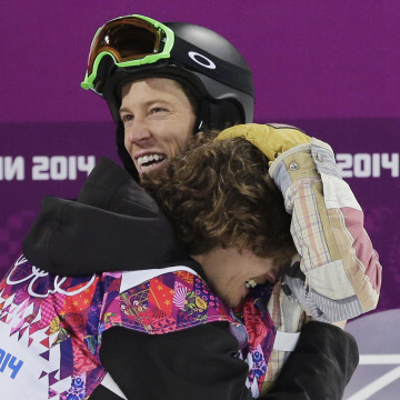 Switzerland's Iouri Podladtchikov, bottom, celebrates with Shaun White of the United States after Podladtchikov won the gold medal in the men's snowboard halfpipe final at the 2014 Winter Olympics.