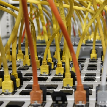 Image: Data cables connected to a server are seen in Stuttgart, Germany