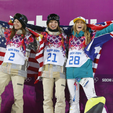 From left, bronze medalist United States' Kelly Clark, gold medalist United States' Kaitlyn Farrington and silver medalist Australia's Torah Bright pose following the women's snowboard halfpipe final at the Rosa Khutor Extreme Park.
