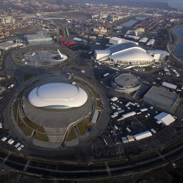 Image: An aerial view from a helicopter shows the Olympic Park under construction in the Adler district of the Black Sea resort city of Sochi.