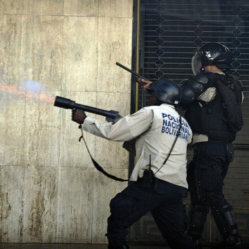 Image: Riot policemen shoot at anti-government students
