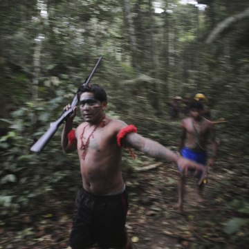 Image: Munduruku Indian warriors search for illegal gold mines and miners in their territory near the Das Tropas river in western Para state