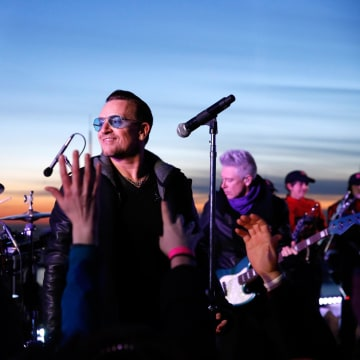 Image: Bono performs with U2 at the Top of the Rock.