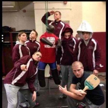 A photo that appears to show seven Phillipsburg High School boys with a wrestling dummy hanging by its neck