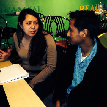 Image: Tania Ruiz, an in-person assistant of the La Clínica del Pueblo, assists José Morales with the details of the new Affordable Care Act