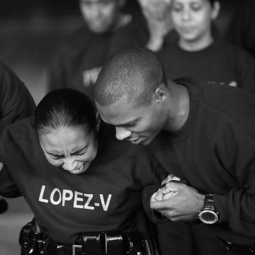 Image: Los Angeles Police recruits Chris Montague, left, and Clay Bell, right, hold Vanessa Lopez as her body is charged with taser voltage