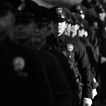 Image: Members of the 5-10 Los Angeles Police Department recruit class line up for graduation