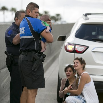 Image: Sweetwater officer Amauris Bastidas helps rescue a five-month-old baby boy