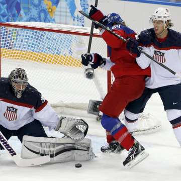 Image: Team USA's goalie Quick makes a save as Czech Republic's Voracek and Team USA's Carlson battle in front of net during the third period of their men's quarter-finals ice hockey game at the 2014 Sochi Winter Olympic Games