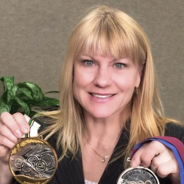 Former Olympian Cathy Turner poses with the medals she won in 1992 in Albertville and in 1994 in Lillehammer.