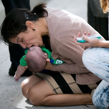 Image: Pamela Rauseo, 37, performs CPR on her nephew, five-month-old Sebastian de la Cruz