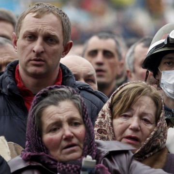 Image: People pray during a funeral service for two anti-governent protesters who were killed after days of violence in Kiev