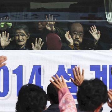 Image: South Korean visitors wave to their North Korean relatives before leaving on a bus for South Korea.