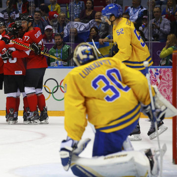 Image: Canada's Toews celebrates his goal with his linemates after scoring on Sweden's goalie Lundqvist as Sweden's Ericsson skates past during the first period of their men's ice hockey gold medal game at the Sochi 2014 Winter Olympic Games