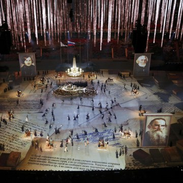 Image: Pictures of Russian writers and poets are seen as performers take part in the closing ceremony for the 2014 Sochi Winter Olympics