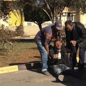 Image: Relatives of seven Egyptians killed in a beach react outside the morgue in Benghazi