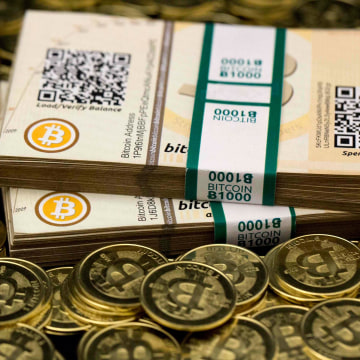 "Image: Some of Bitcoin enthusiast Mike Caldwell's coins and paper vouchers often called ""paper wallets"" are pictured at his office in Sandy, Utah"