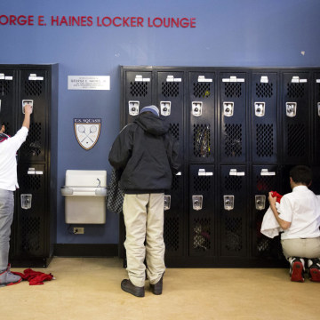 Image: Youths get their things from lockers before squash practice at the Lenfest Center