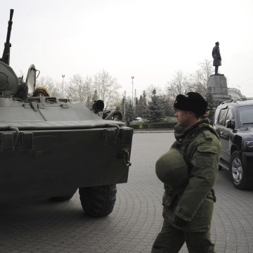 Image: A Russian armored personnel carrier is driven on a street in Sevastopol