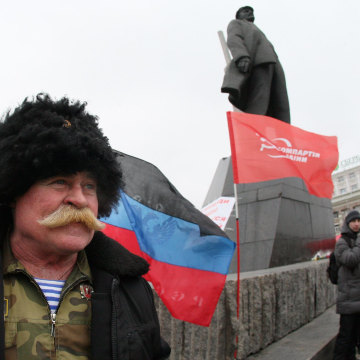 Image: Ukrainian Communist Party activist near Lenin monument in Donetsk