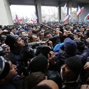 Image: Pro-Russian protesters, left, clash with Crimean Tatars
