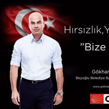 """Theft and corruption. Not in our book"" says a campaign poster for would-be opposition candidate and CHP party member Gohkan Eseli."