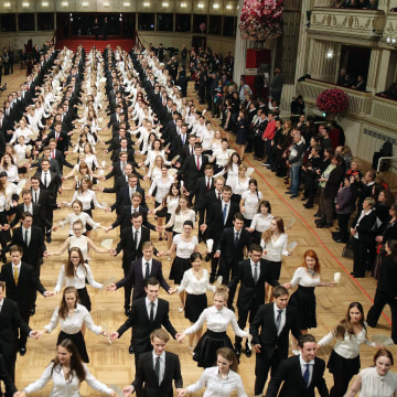 Image: Members of the opening committee peform during the final rehearsal for the Opera Ball inside the opera house in Vienna